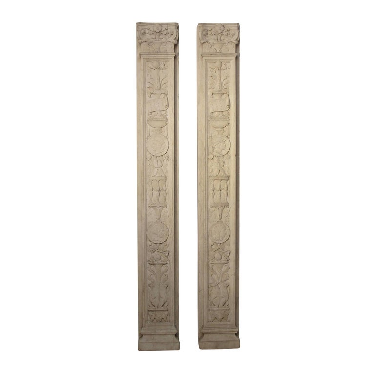 A pair of finely carved solid marble pilasters or architectural elements in the neoclassical manner, Italy, circa 1920.