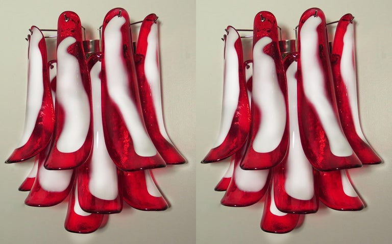 "Pair of vintage Italian Murano appliques in the manner of Mazzega. Wall lights have 10 red and white ""lattimo"" glasses (for each applique) in a nickel-plated metal frame.