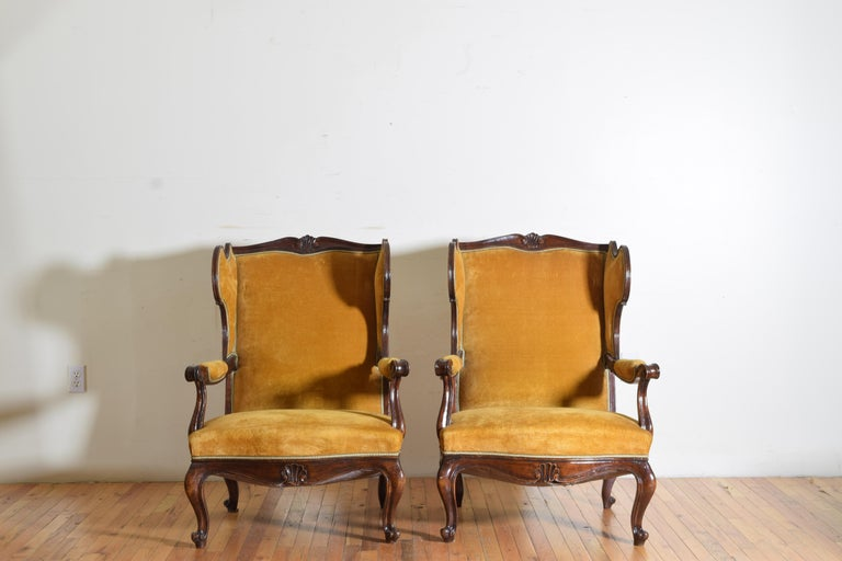 Pair of Italian Rococo Revival Style Walnut and Upholstered Wingchairs For Sale 1