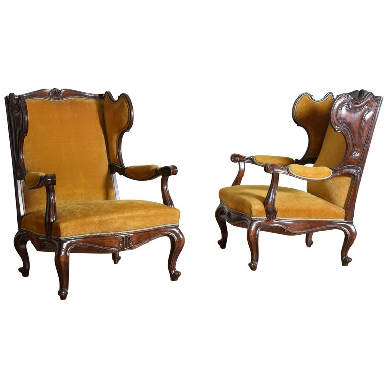 Pair of Italian Rococo Revival Style Walnut and Upholstered Wingchairs For Sale