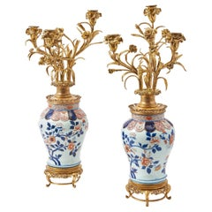 Pair of Japanese Imari Baluster Vases with Later French Ormolu Candelabra