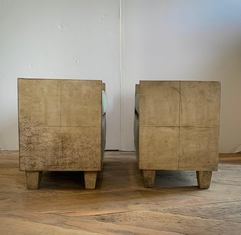 A handsome pair of goatskin parchment Jean-Michael Frank style benches newly upholstered in a greige mohair. Minimalist in design, these seats make a stunning statement to any decor.