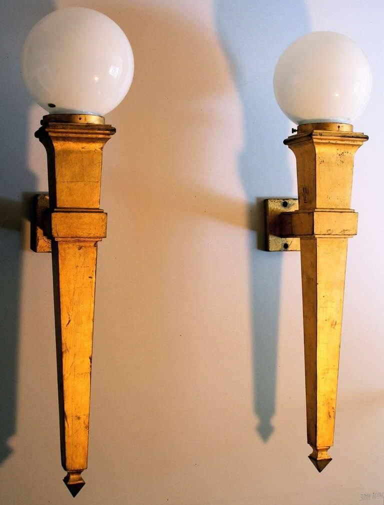 A pair of very large (27.5 inches high-exclusive of globes) Gilded Cast Iron (21 lbs. each) Wall Sconces. Not signed or otherwise marked.