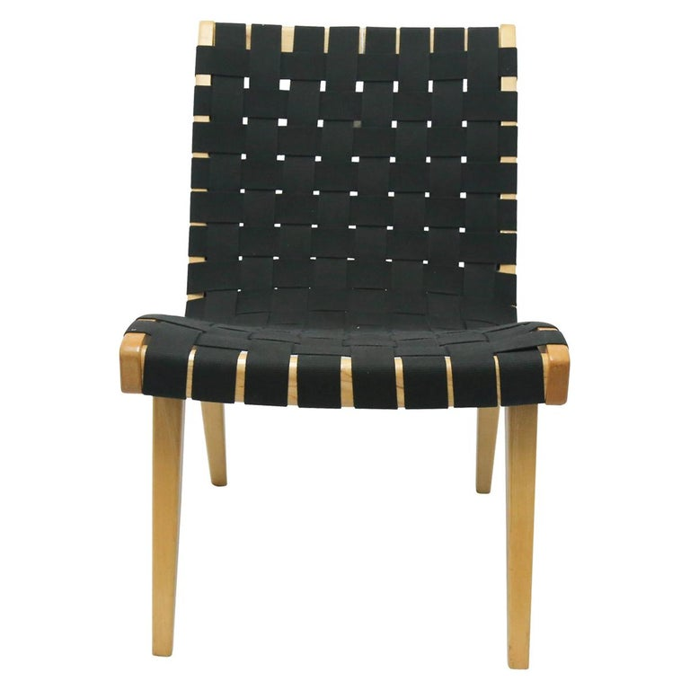 Pair of black strap weaved Jens Risom lounge chairs for Knoll. The chair was manufactured in the 1960s. The chair comes as a pair.