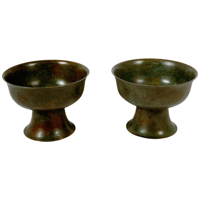 An exquisite pair of Korean bronze pedestal offering bowls, Goryeo Dynasty, 13th-15th century, Korea.   The Goryeo bronze bowls of generous proportions, with high sides and an ever so slightly everted rim. The bowls are supported on a pedestal
