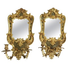 Pair  Large Bronze Mirrored Back Sconces