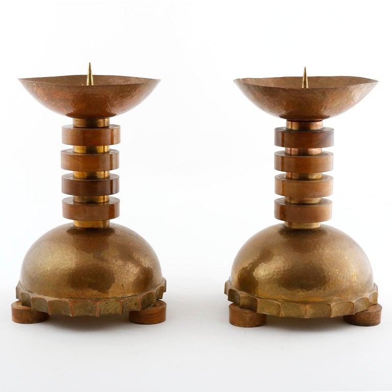 A pair of large and gorgeous candlesticks manufactured, circa 1930. They are made of nut wood, hammered brass and copper with wonderful patina.