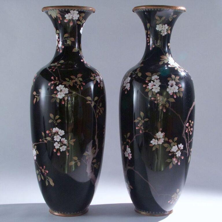 Pair of large Japanese cloisonné vases depicting exotic birds.
