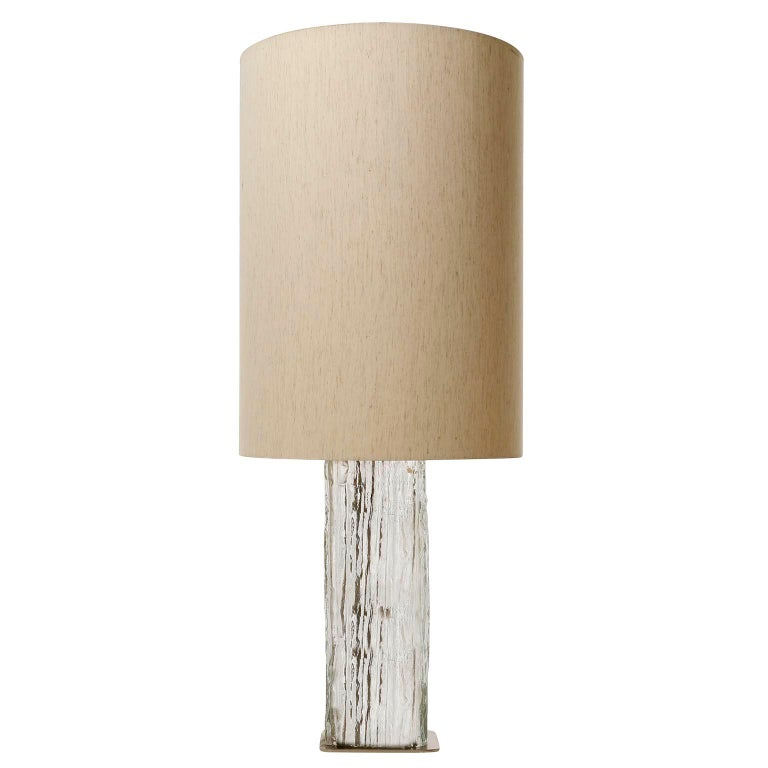 A pair of rare and large table lamps model 'Frankenberg', no. 1359 by Kalmar, Austria, manufactured in Mid-Century, circa 1970 (late 1960s or early 1970s).  A nickeled base with a large hand blown iced and textured glass and a cream or beige