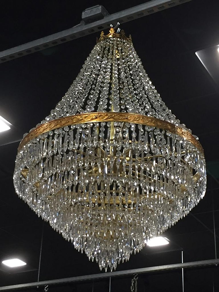 20th Century Large Midcentury Italian Wedding Cake Style Brass and Crystal Chandeliers, Pair For Sale