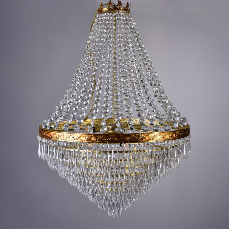Metal Large Midcentury Italian Wedding Cake Style Brass and Crystal Chandeliers, Pair For Sale