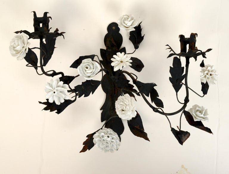 A pair of late 18th century French tole floral sconces with white porcelain flowers. The paint appears original.