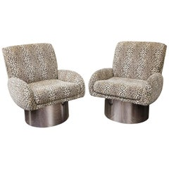 Pair of Leon Rosen Swivel Chairs