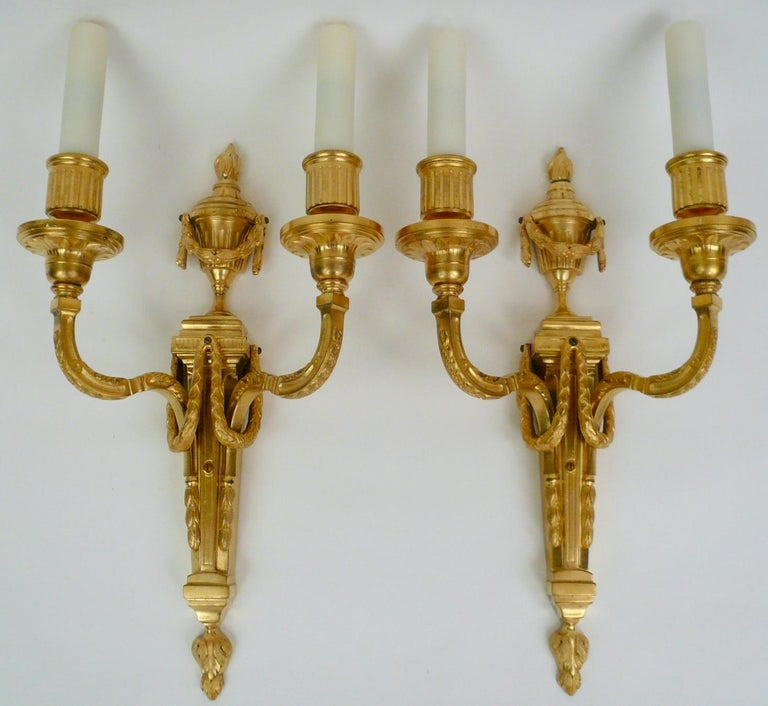 American Pair Louis XVI Style Gilt Bronze Sconces by E. F. Caldwell For Sale