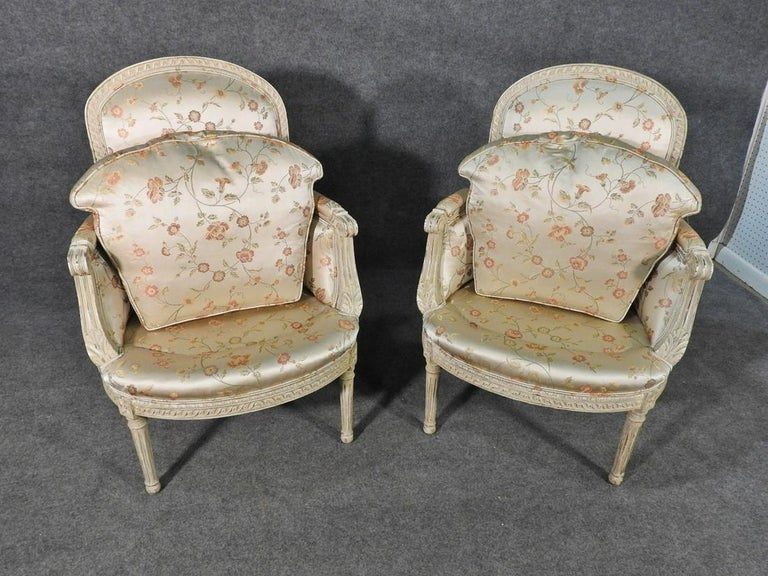 Pair Louis XVI Style Maison Jansen Bergeres in A Distressed Frame having a Scalamandre upholstery. Simply stunning white washed finely carved frames covered in a raised Scalamandre frbric having floral design throughout. Strong and Sturdy.  hLX