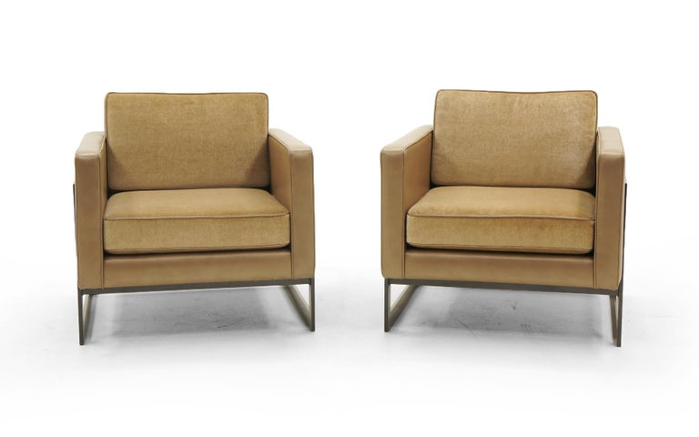 Pair of cube shaped lounge chairs by Milo Baughman for Thayer Coggin.  Reupholstered chair bodies in camel color leather and seat cushions in a matching mohair fabric.  The frames have been professionally powder coated in a dark espresso slightly