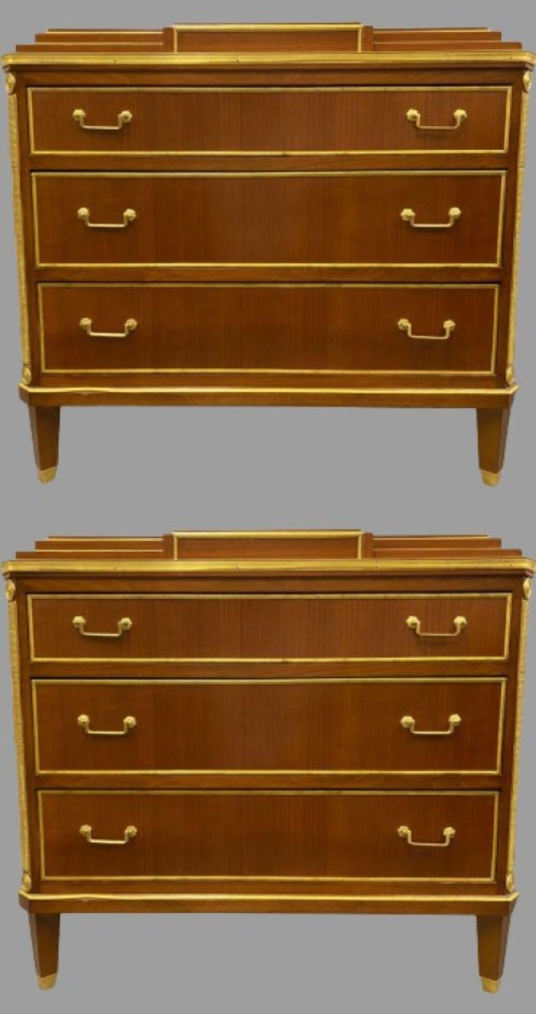 Pair of mahogany double step up Russian neoclassical style commodes. Each of these custom quality commodes have fine polished mahogany finishes decorated with bronze mounts. The tapering legs with bronze sabots support a three drawer bronze framed