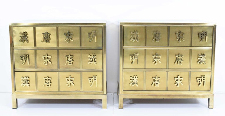 A fine pair of Hollywood Regency style mastercraft commodes, chests or nightstand in wood and brass veneer depicting the four dynasty's.