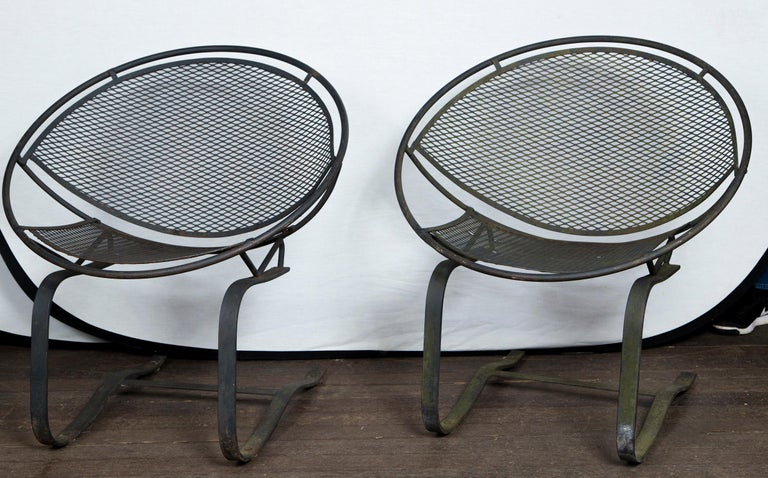 A pair of Maurizio Tempestini for Salterini radar saucer chairs. Hard to find spring version. Mid-Century Modern circa 1950s wrought iron chairs.
