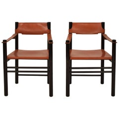 Pair of Midcentury Italian Black Wood and Cognac Leather Armchairs, Ibisco Sedie