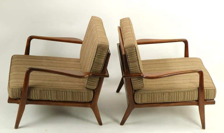 Classic low profile midcentury lounge chairs by recognized master of the period Mel Simlow. Both chairs are in original untouched condition, the frames show some cosmetic wear to finish, scuffs etc., pictured in listing. Measures: Total H 30 x arm H