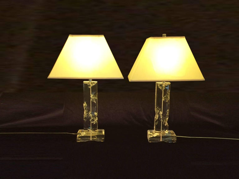Pair of midcentury Lucite table lamps, circa 1970. With a carved ice look.