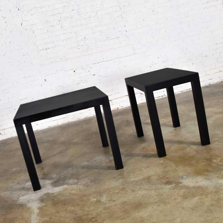 Fabulous pair of Mid-Century Modern black lacquered Parsons style side tables. One (1) square and one (1) rectangle. In beautiful vintage condition. These have been completely refinished and repainted and a urethane coat has been added for