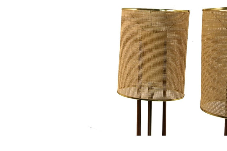 A wonderful impressive pair of large scale, Mid-Century Modern table lamps in the style of Adrian Pearsall by Modeline, circa 1950s. These beauties feature a double shade effect with sculptural walnut frames and three vertical arms, supporting a