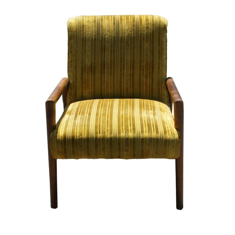 Pair of arm lounge chairs by T.H. Robsjohn-Gibbings.