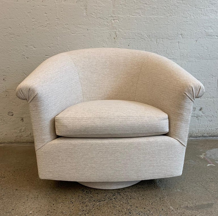 Pair of Milo Baughman style swivel lounge chairs. Newly upholstered.