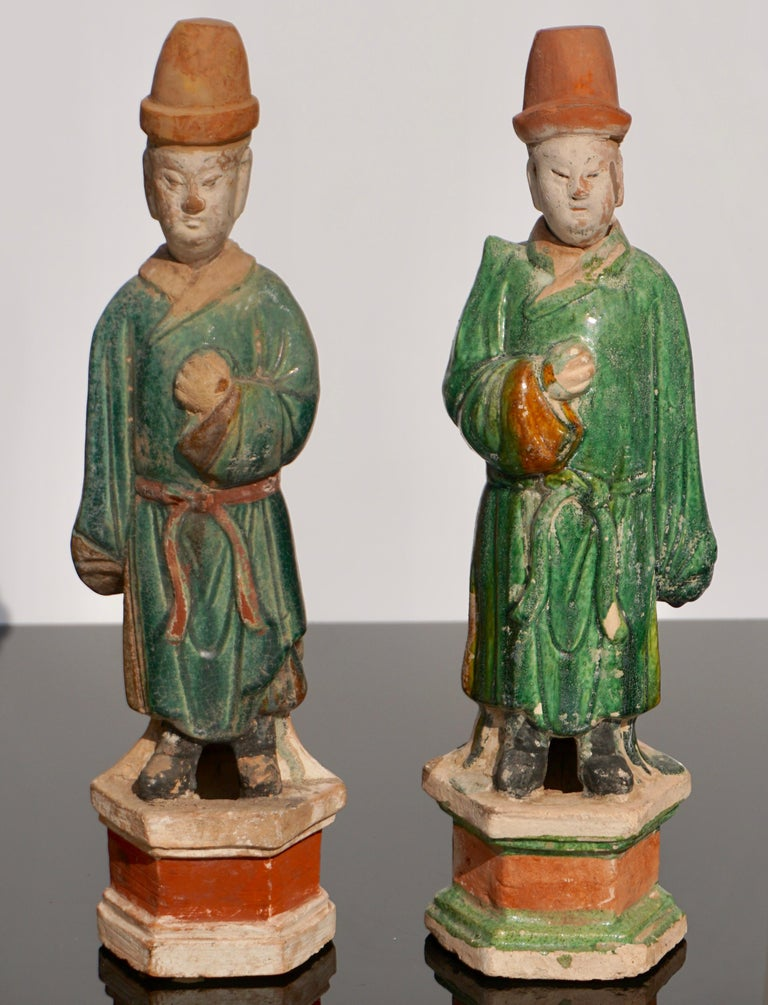A wonderful pair of Sancai glazed terracotta tomb attendee figures. These colors of green and cream add depth and class to any decor and are very charming as an extra bonus. Ming Dynasty (1368-1644 AD)