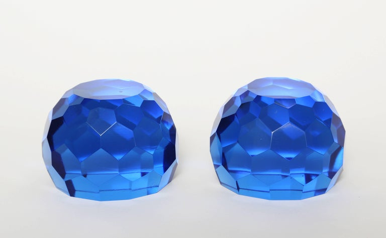 Unusual to find a pair of matched paperweights, probably made for a partner's desk. This pair of blown, hand-cut and multifaceted azure blue paperweights remain in excellent condition.  (This item is eligible for a gift box)