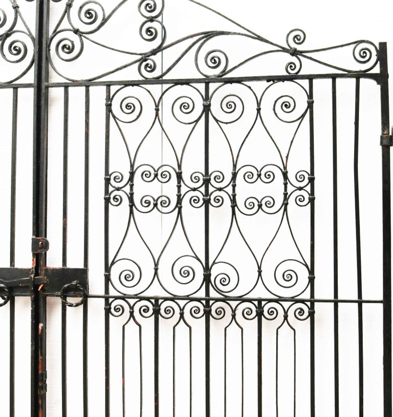 About  A pair of good quality wrought iron drive gates. Reclaimed from a private house in Surrey. These will span an opening of approximately 11'7? (356 cm)  Condition Report  In good structural condition. Paint in reasonable condition. Some