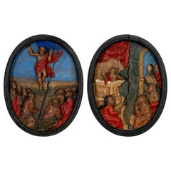 Pair of 17th Century Carved and Painted Oval Religious Plaques