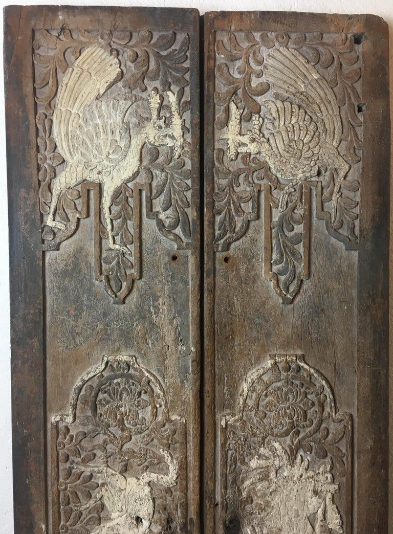 Antique Chinese architectural carved panels or possibly a door from the 17th Century in completely organic form, un-restored condition. These doors have a remarkable patina and are very decorative.   The hand carvings in high relief and featuring