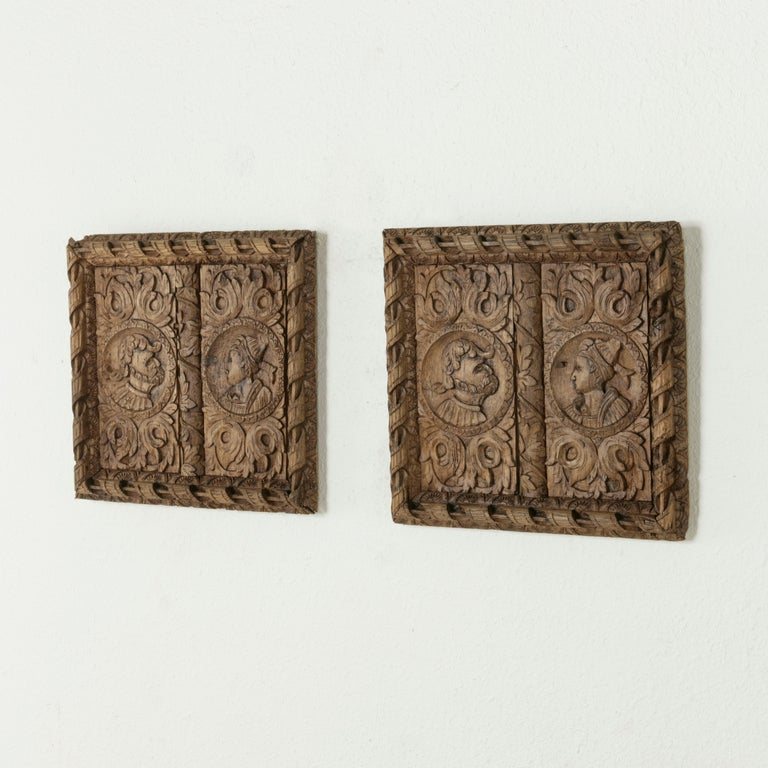Originally inset in a coffer or traveling chest, this pair of French hand carved oak panels from the seventeenth century features profiles of a noble husband and wife. Intricately carved stylized leaves surround each profile, and a deep relief