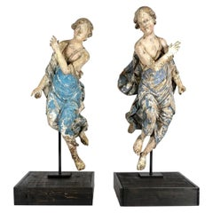 Pair of 17th Century Italian Carved and Polychrome Angel Figures