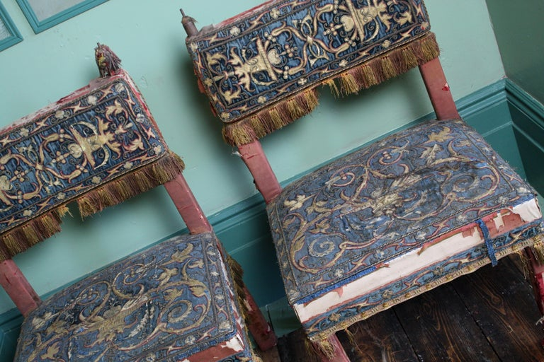 Worn and wonderfully, a sculptural pair of totally unrestored 17th century style chairs, upholstered in silk and wire work floral scrolls by George Trollope & Son 