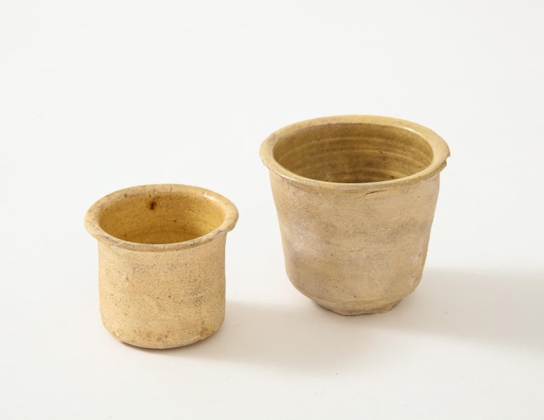 Pair of late 18th-early 19th century small very thin, delicately formed ceramic pots, Netherlands Ceramic, glazed interior, textured matte exterior Measures: Height 2.25, diameter 2.75 in. Height 1.75, diameter .75 in.