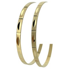 Pair of 18 Karat Yellow Gold Diamond Cut Bangle Bracelets
