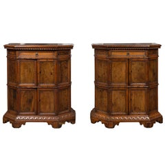 Pair of 1800s Italian Carved Walnut Cabinets with Canted Sides, Drawer and Doors