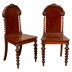 Pair of 1880s English Barley Twist Oak Hall Chairs with Foliage and Acorn Motifs