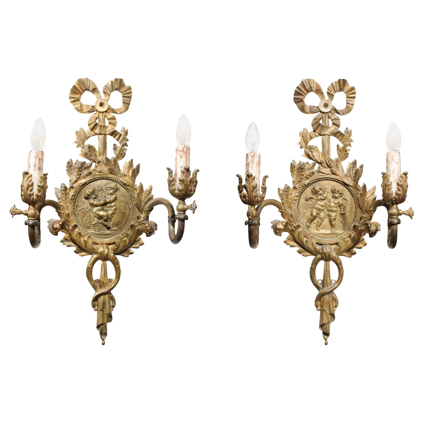Pair of 1890s French Two-Light Brass Sconces with Ribbon, Cherubs and Satyrs