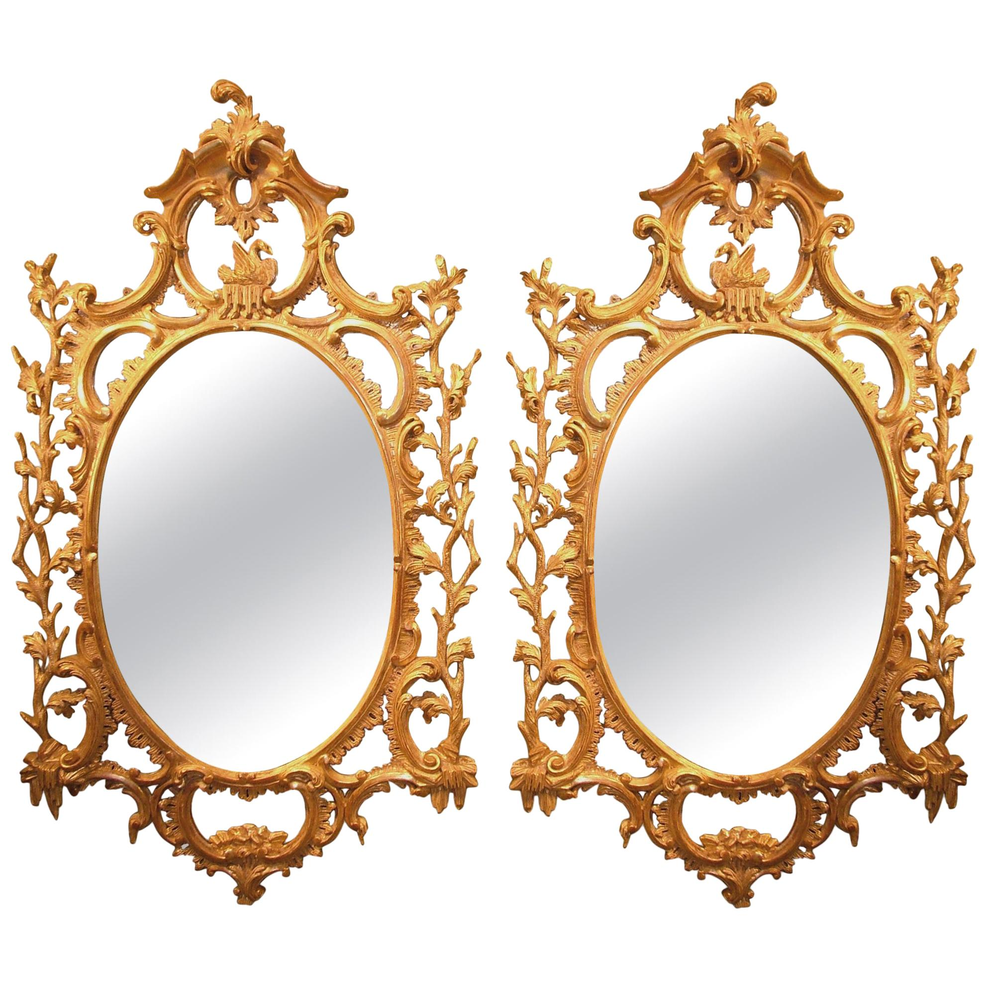 Pair of 18th Century Carved Oval Giltwood Mirrors