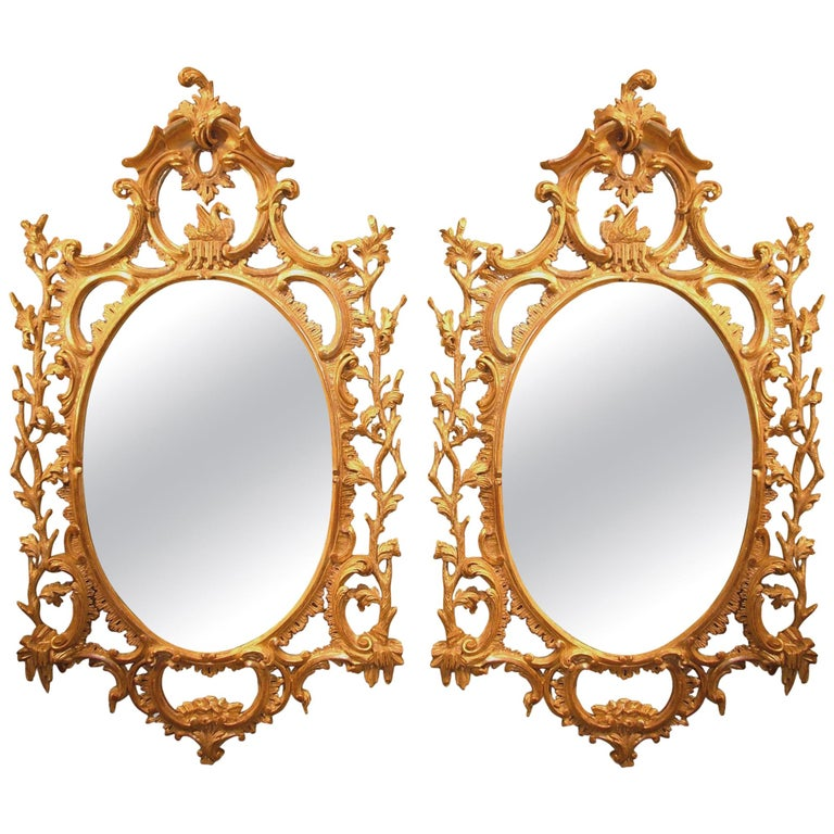 Pair of 18th Century Carved Oval Giltwood Mirrors For Sale