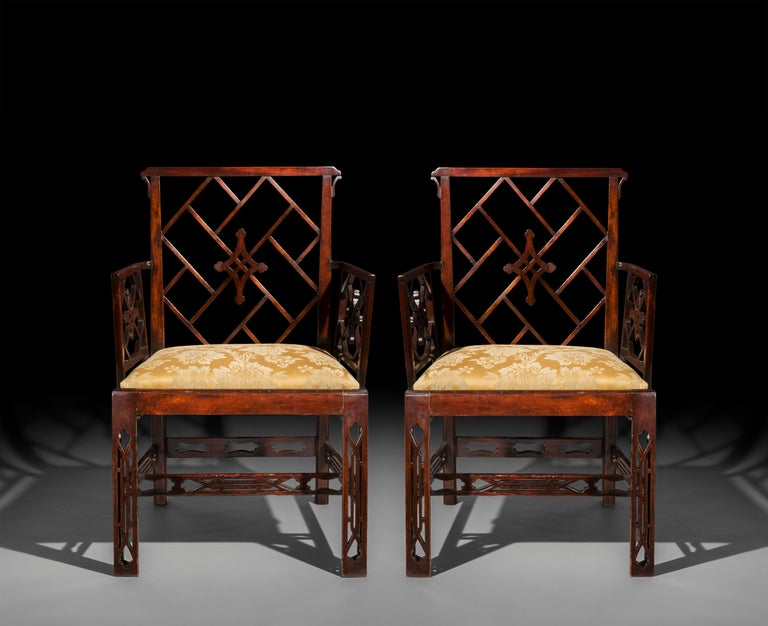 Pair of George III Chinese Chippendale mahogany armchairs, after a design by Mayhew & Ince,