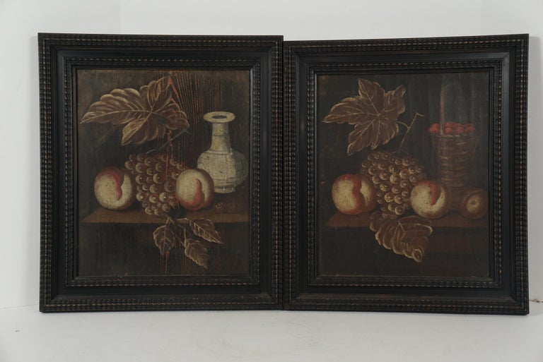 The pair are painted on wood panel and done circa 1760 by a country artist working from life. Each composition is very similar but subtly different and incorporating different leaves and or objects while retaining the same fruit. Both panels show