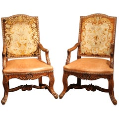 Pair of 18th Century French Carved Walnut, Leather and Needlepoint Armchairs