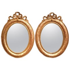 Pair of 18th Century French Louis XVI Carved Giltwood Oval Wall Mirrors