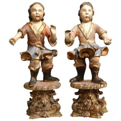 Pair of 18th Century Italian Carved Polychrome and Gilt Cherub Sculptures